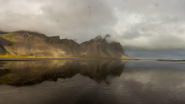 T/L Cloudscape over Icelandic rocky coastline video