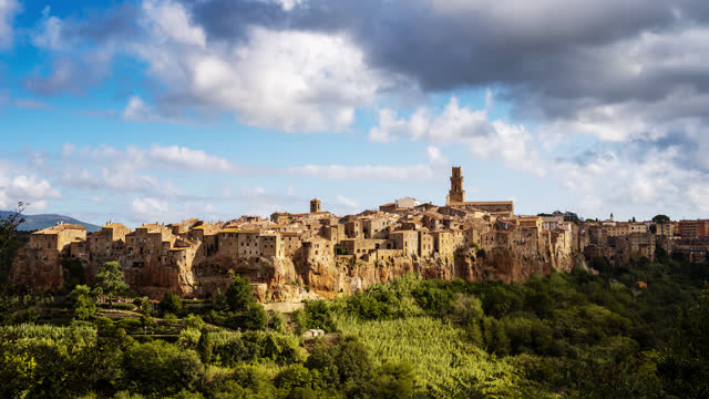 T/L Cloudscape over medieval town on top of plateau in Italy, Civita di Bagnoregio