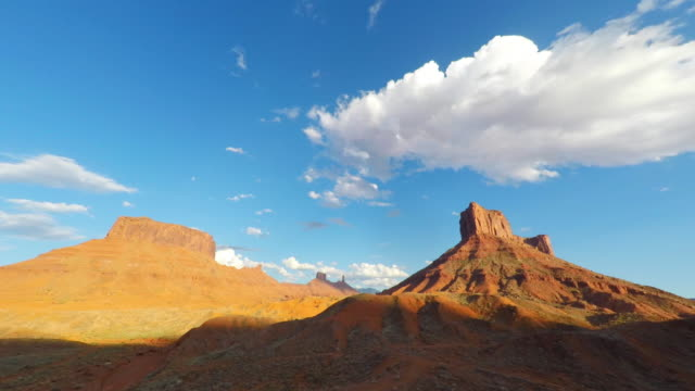 Cloudscape Timelapse Over Mesa Rock Tower Near Moab, Utah Fast moving cloudscape timelapse over red mesa rock formations in the desert outside of Moab, Utah sandstone stock videos & royalty-free footage