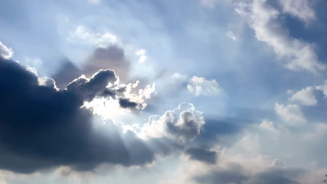cloudscape with bright sun shining with clouds passing. video