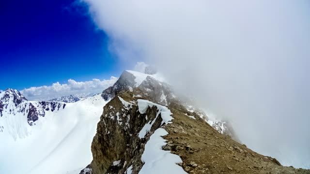 Cloudy at the top of the ridge mountain Sairam-Su video