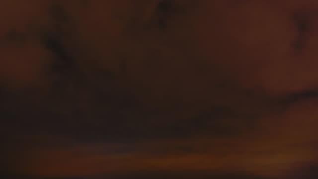 Cloudy sky over night city. Timelapse of night sky over city. video