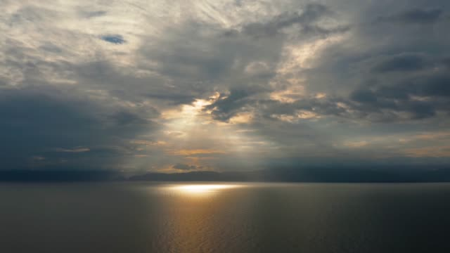 Cloudy sky over the sea during sunset