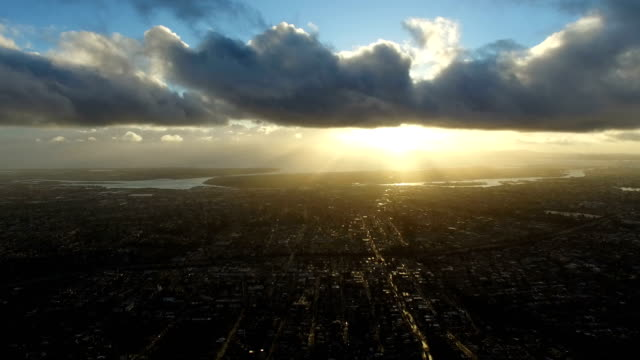 Cloudy Sunset over the City Dramatic clouds and the sun setting over Oakland, CA make for a beautiful aerial scene. oakland stock videos & royalty-free footage