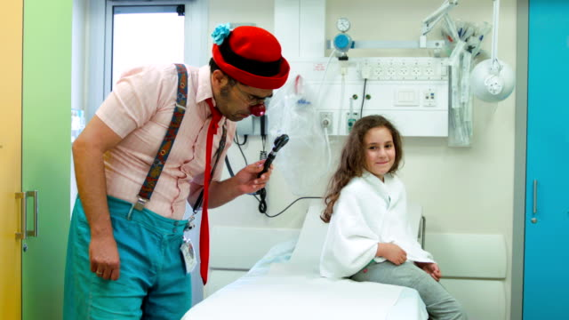 Clown  amuses the girl in hospital video