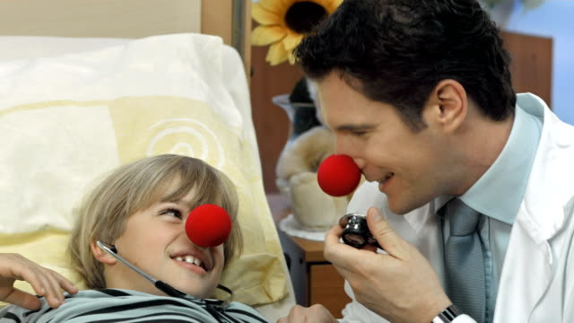 HD DOLLY: Clown Doctor Entertaining A Sick Child video