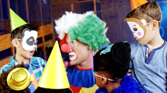 Clown interacting with the kids during birthday party 4k video