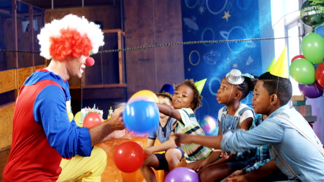 Clown playing with the kids during birthday party 4k video