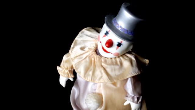 Clown toy dancing Old vintage toy,clown moving around on black background doll stock videos & royalty-free footage