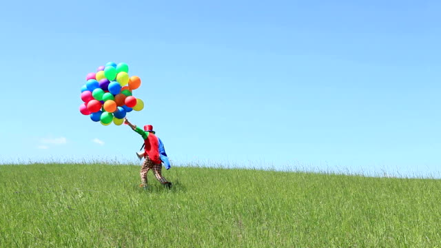 Clown with balloons on field video