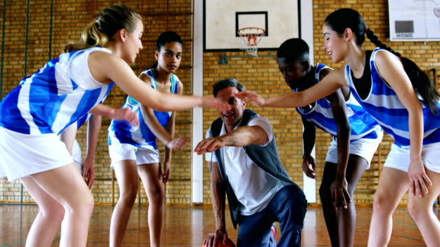 Coach and schoolkids forming hand stack 4k Coach and schoolkids forming hand stack in court 4k coach stock videos & royalty-free footage