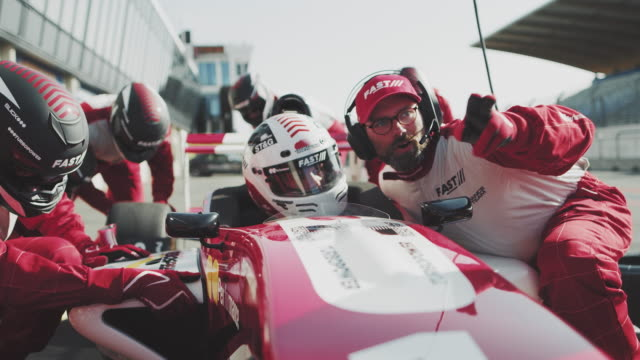 Coach instructing racer at pit stop
