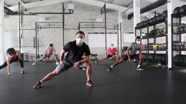 Coach Leading Socially Distanced Workout in Time of COVID-19 video