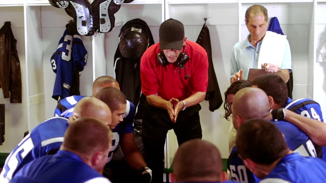 Coach motivates players in locker room