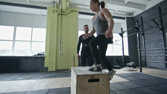 Coach Motivating Woman During Box Jump Workout video