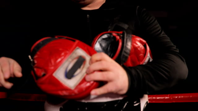 coach putting on training equipment for boxing practice - guanto indumento sportivo protettivo video stock e b–roll