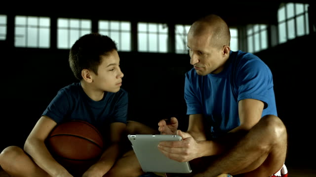 HD DOLLY: Coach Showing Basketball Attack Strategies video
