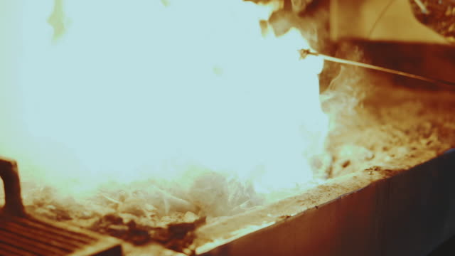 Coal burning in Barbecue video