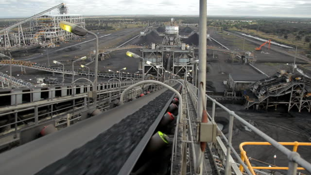 Coal conveyor rapidly moving Coal at a Coal Mine. video