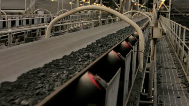 Coal conveyor A conveyor belt carrying coal at a mine site. coal stock videos & royalty-free footage
