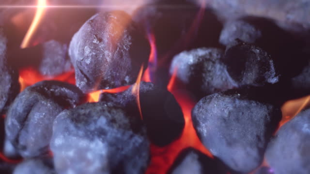 Coal Fire tracking shot. HD Shot of a coal fire, the camera tracks right to left. 19th century style stock videos & royalty-free footage