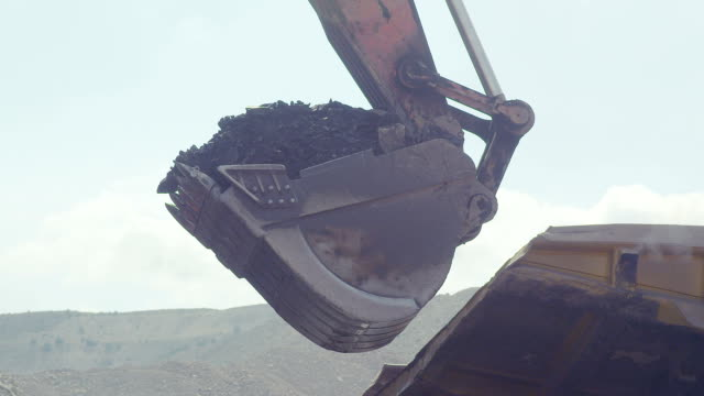 Coal loading excavator, loading of coal video