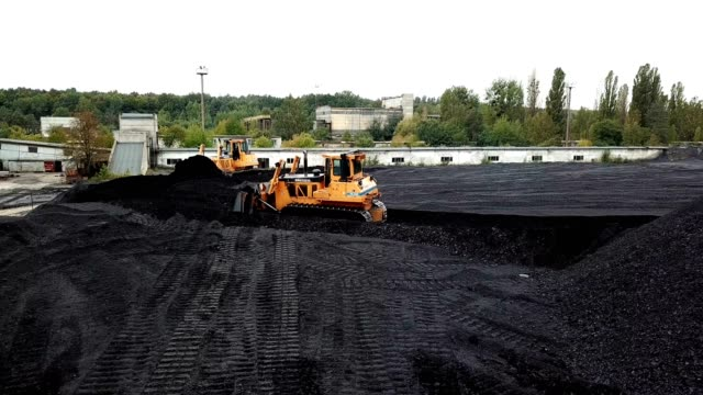 Coal mining at an open pit. Coal mining at an open pit. Fossil fuel industry. Environmental challenge. Aerial view. construction vehicle stock videos & royalty-free footage