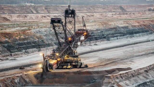 Coal Mining Machinery At Open-Pit Mine - Time Lapse Time lapse of a giant Bucket Wheel Excavator digging through sediment layers in lignite surface mine Hambach in North Rhine Westphalia, Germany. construction vehicle stock videos & royalty-free footage