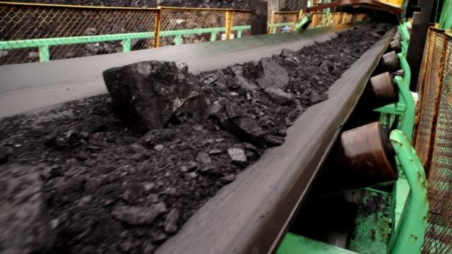 Coal on conveyor belt in rainy weather Coal on conveyor belt in rainy weather (HD) conveyor belt stock videos & royalty-free footage