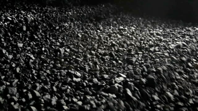 Coal Processing conveyor Large Volumes of black coal move through a processing machine to create clean coal at a Coal Mine. coal stock videos & royalty-free footage