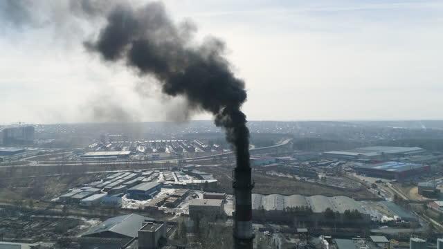 Coal station chimneys emit black smoke Environmental pollution 4K aerial