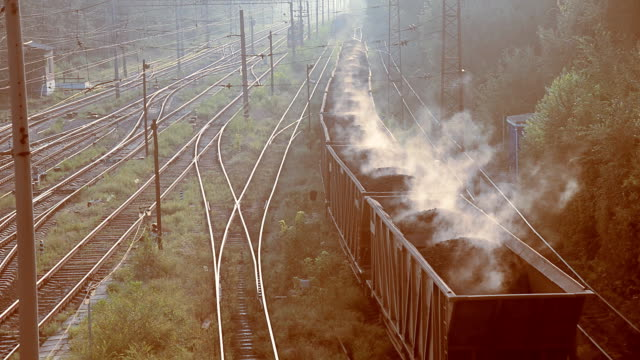 Coal. Wagons with burning coal go to the plant video