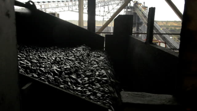 Coal wash conveyor A conveyor belt washing and processing coal at a mine site. coal stock videos & royalty-free footage