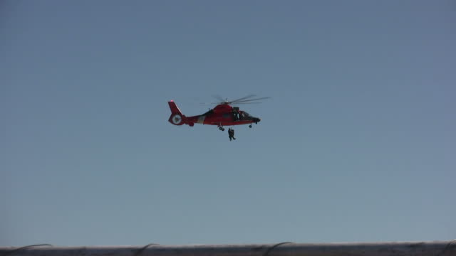 Coast Guard operation Coast Guard helicopter performing rescue medevac stock videos & royalty-free footage
