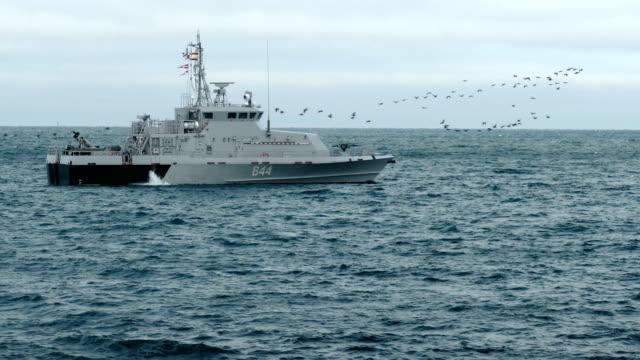 Bидео coast guard ship patrolling at sea