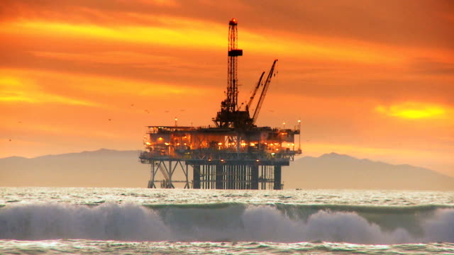 Coastal Oil Rig Sunset Silhouette video