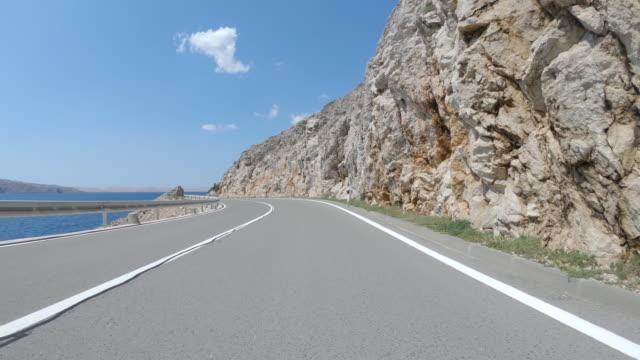 coastal road car travel - strada tortuosa video stock e b–roll