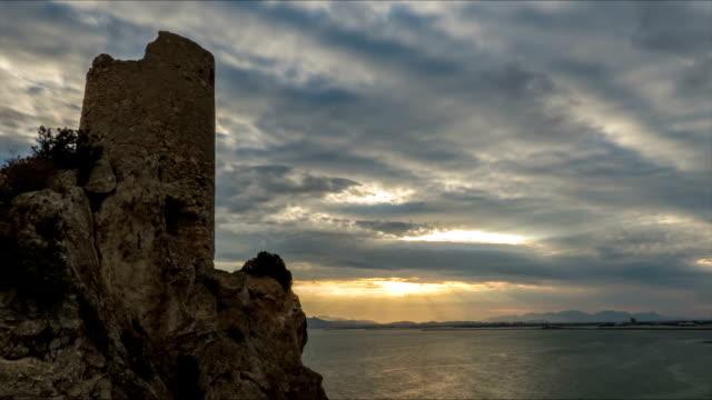 torre della costa del golfo di cagliari al tramonto - sardegna video stock e b–roll
