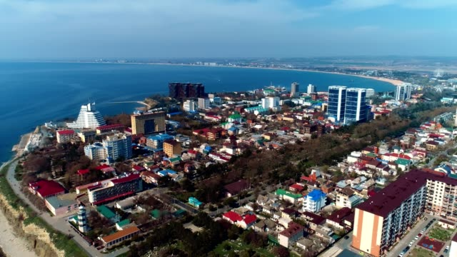 Coastal town in Russia, Anapa with buildings, waterfront and sea view, aerial footage.