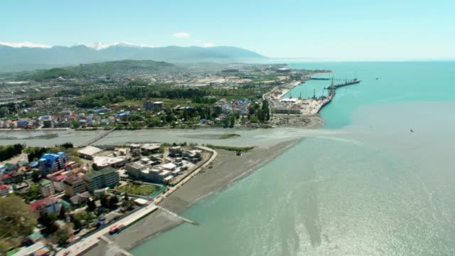 Aerials. Russia - Sochi 2012: Coastline of the city. View of the seaport. video