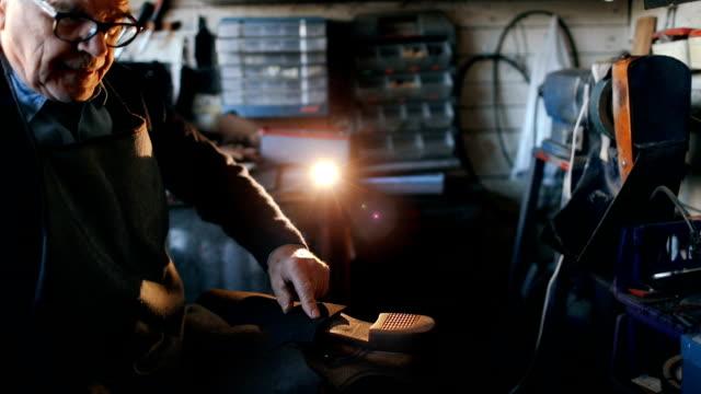Cobbler repairing shoe sole video