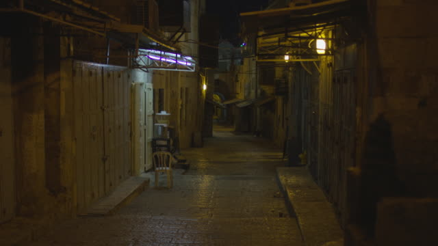 Cobblestone street at night Cobblestone street at night. alley stock videos & royalty-free footage