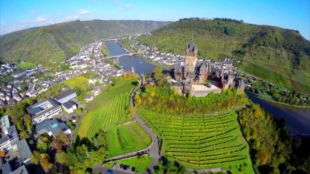 Cochem Castle from above, medieval fort building aerial, village. Beautiful aerial shot above Europe, culture and landscapes, camera pan dolly in the air. Drone flying above European land. Traveling sightseeing, tourist views of Germany. video