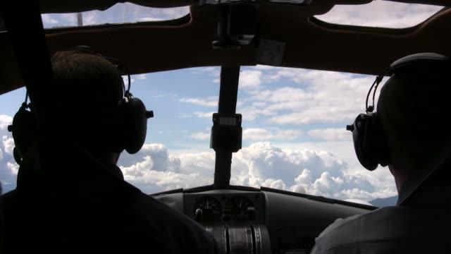cockpit view of seaplane flying into clouds - pilot bildbanksvideor och videomaterial från bakom kulisserna