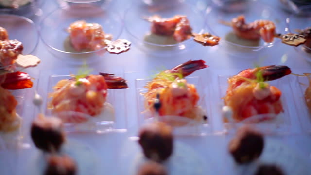 Cocktail Party Food Cocktail Party Food served in a modern restaurant aperitif stock videos & royalty-free footage