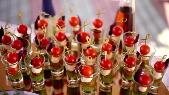 cocktail snacks with cherry tomatoes - antipasto video stock e b–roll
