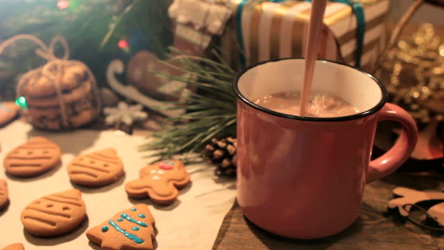 Cocoa break during decoration process of cookies