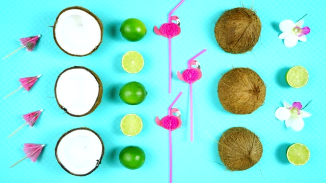 Coconut summertime theme flat lay creative layout overhead. Coconut summertime theme flat lay creative layout overhead with drinking, straws, coconuts and limes on modern blue background. Stop motion animation continuous loop. margarita stock videos & royalty-free footage
