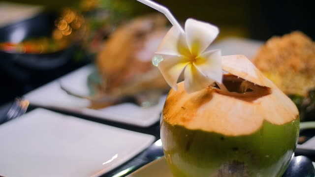 Coconut water on a dinning table.