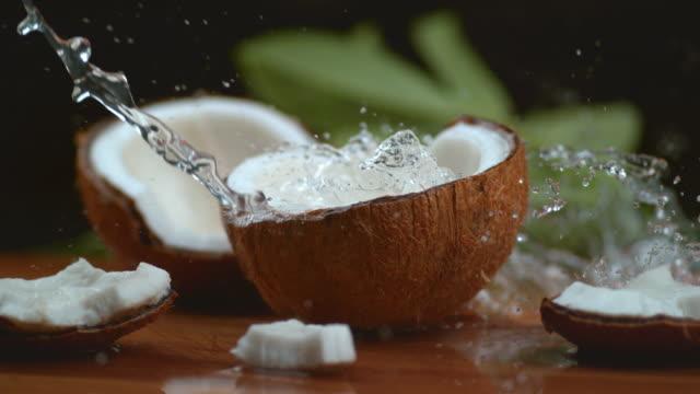 Coconut water splashing in super slow motion Coconut water splashing in super slow motion, shot with Phantom Flex 4K coconut stock videos & royalty-free footage